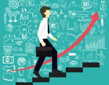41742511 - a business man steps up stairs to successful point with business doodles background.